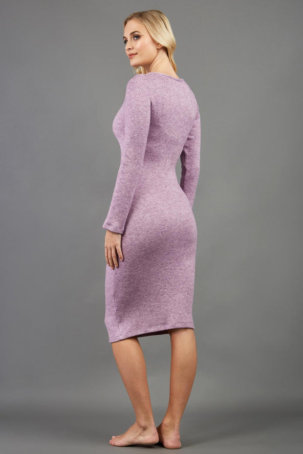 blonde model wearing diva catwalk elstar pencil plain dress made of very soft and cosy cashmere fabric with long sleeves in pink back