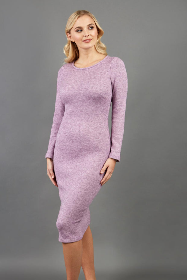 blonde model wearing diva catwalk elstar pencil plain dress made of very soft and cosy cashmere fabric with long sleeves in pink front