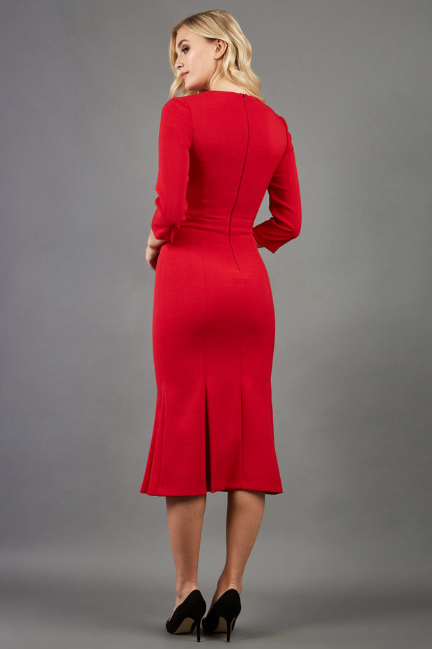 blonde model is wearing diva catwalk senne midaxi sleeved dress with fishtail and rounded neckline with a slit in the middle in red back