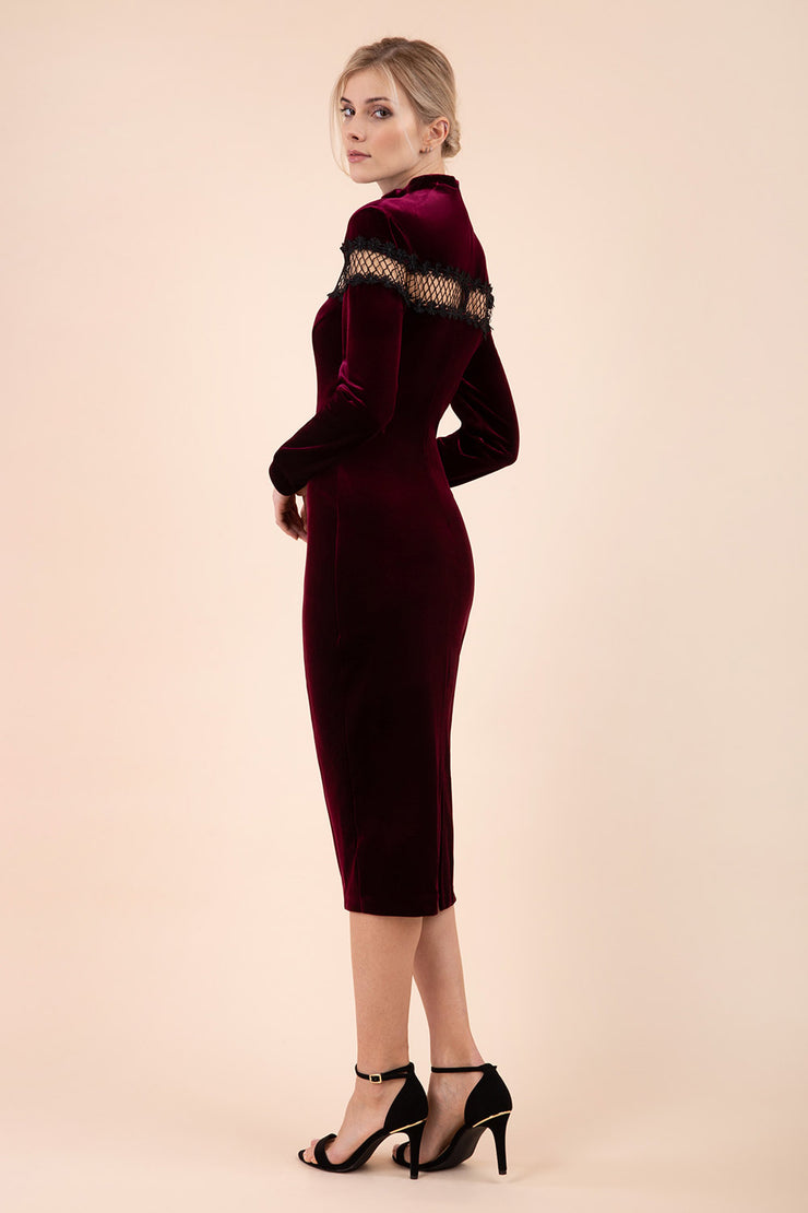blonde model wearing diva catwalk burgundy pencil dress called trocadero pencil midaxi style with funnel neckline and lace detail and long sleeves back
