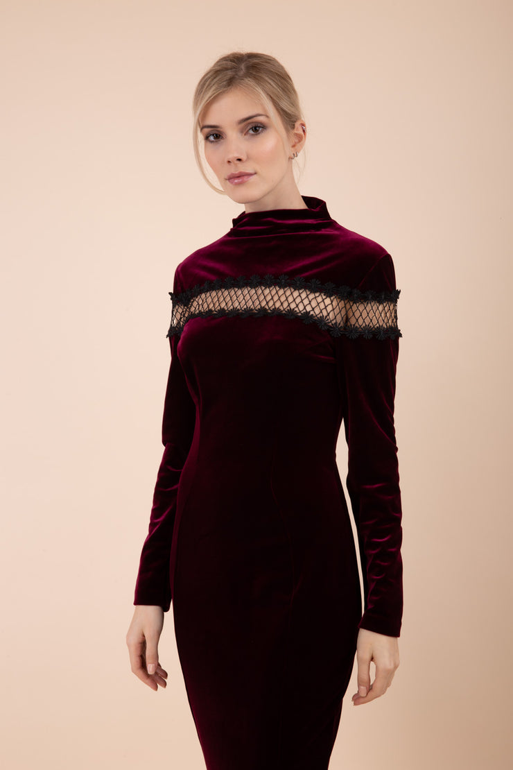 blonde model wearing diva catwalk burgundy pencil dress called trocadero pencil midaxi style with funnel neckline and lace detail and long sleeves front