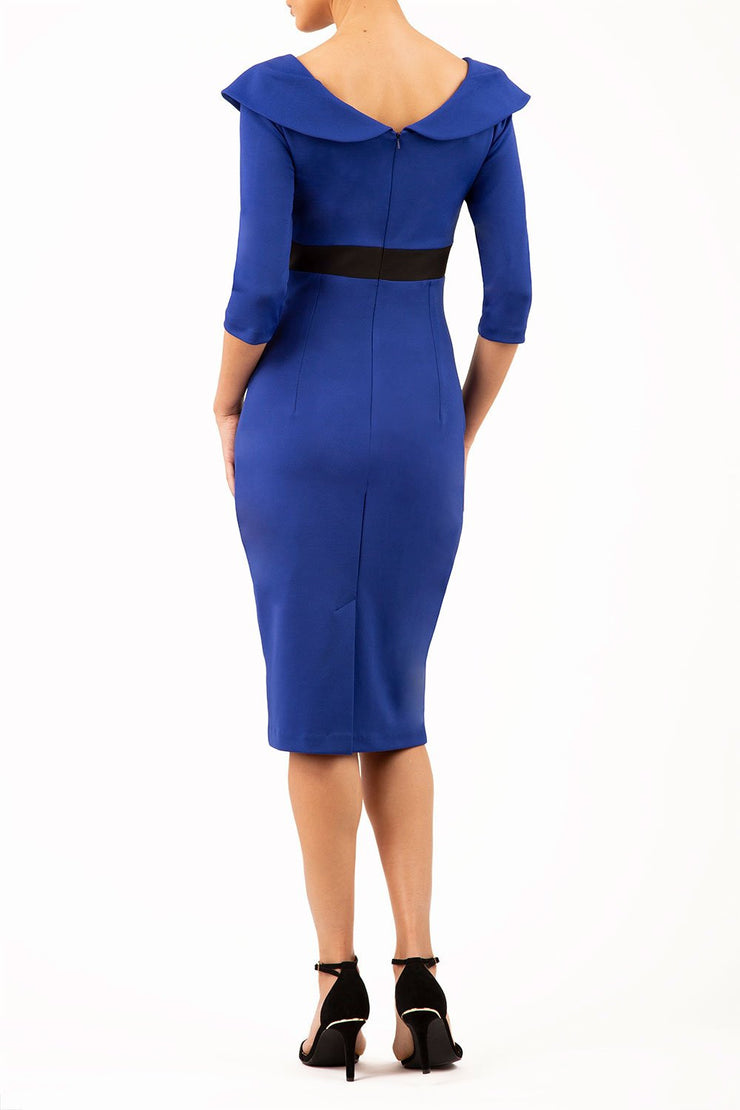 model wearing diva catwalk royal blue pencil-skirt dress  with 3 4 sleeves and pleated pencil skirt and oversized collar back