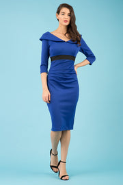model wearing diva catwalk royal blue pencil-skirt dress  with 3 4 sleeves and pleated pencil skirt and oversized collar front