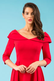 Model wearing the Diva Chesterton Sleeveless dress with oversized collar detail and swing pleated skirt in red front image