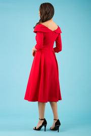 Model wearing the Diva Chesterton Sleeveless dress with oversized collar detail and swing pleated skirt in red back image