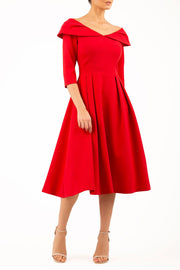 Model wearing Diva Catwalk Chesterton Sleeved dress with oversized collar detail and a-line swing pleated skirt in colour red front