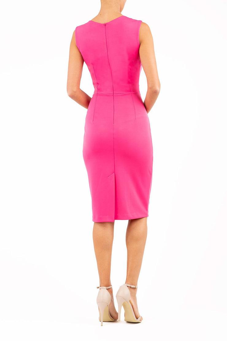model wearing diva catwalk primula pencil skirt dress in pink with pleating on one side and sleeveless design in colour pink back