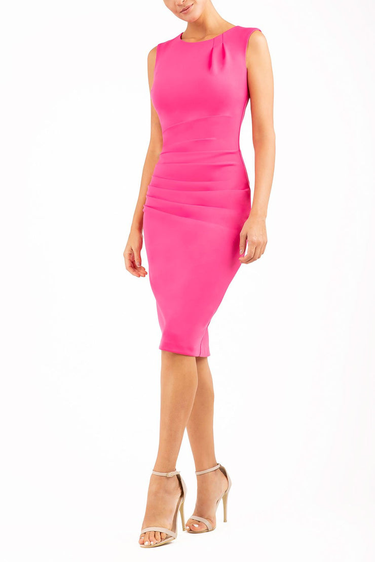 model wearing diva catwalk primula pencil skirt dress in pink with pleating on one side and sleeveless desigh in colour pink front