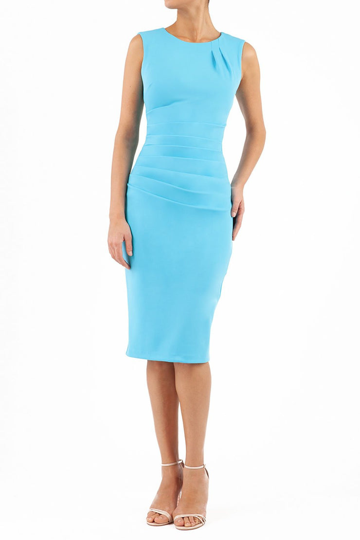 model wearing diva catwalk primula pencil skirt dress in pink with pleating on one side and sleeveless design in colour sky blue front