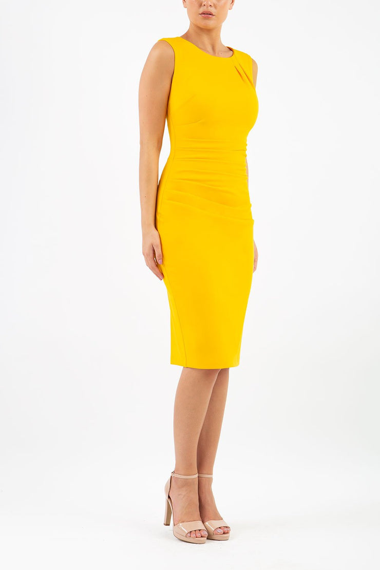 model wearing diva catwalk primula pencil skirt dress in pink with pleating on one side and sleeveless design in colour yellow front