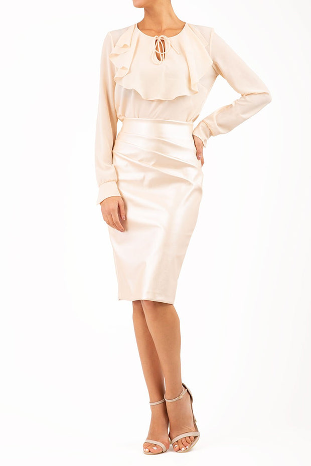 model wearing diva ashford faux leather pencil skirt in pearl ivory front