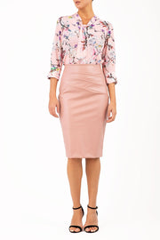 model wearing diva ashford faux leather pencil skirt in pink back