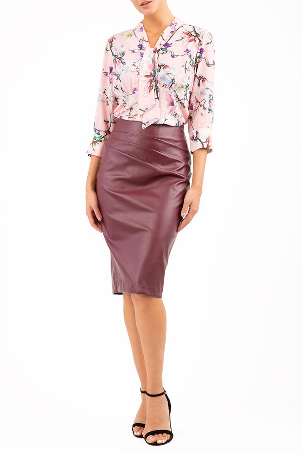 model wearing diva ashford faux leather pencil skirt in burgundy front