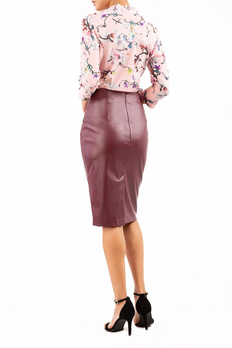 Model wearing the Diva Ashford Faux Leather skirt in burgundy back image