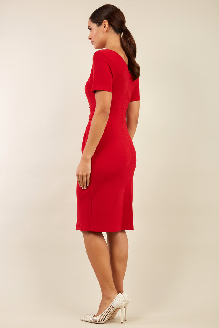 Brunette model is wearing marcel stretch short sleeve pencil dress front image in red