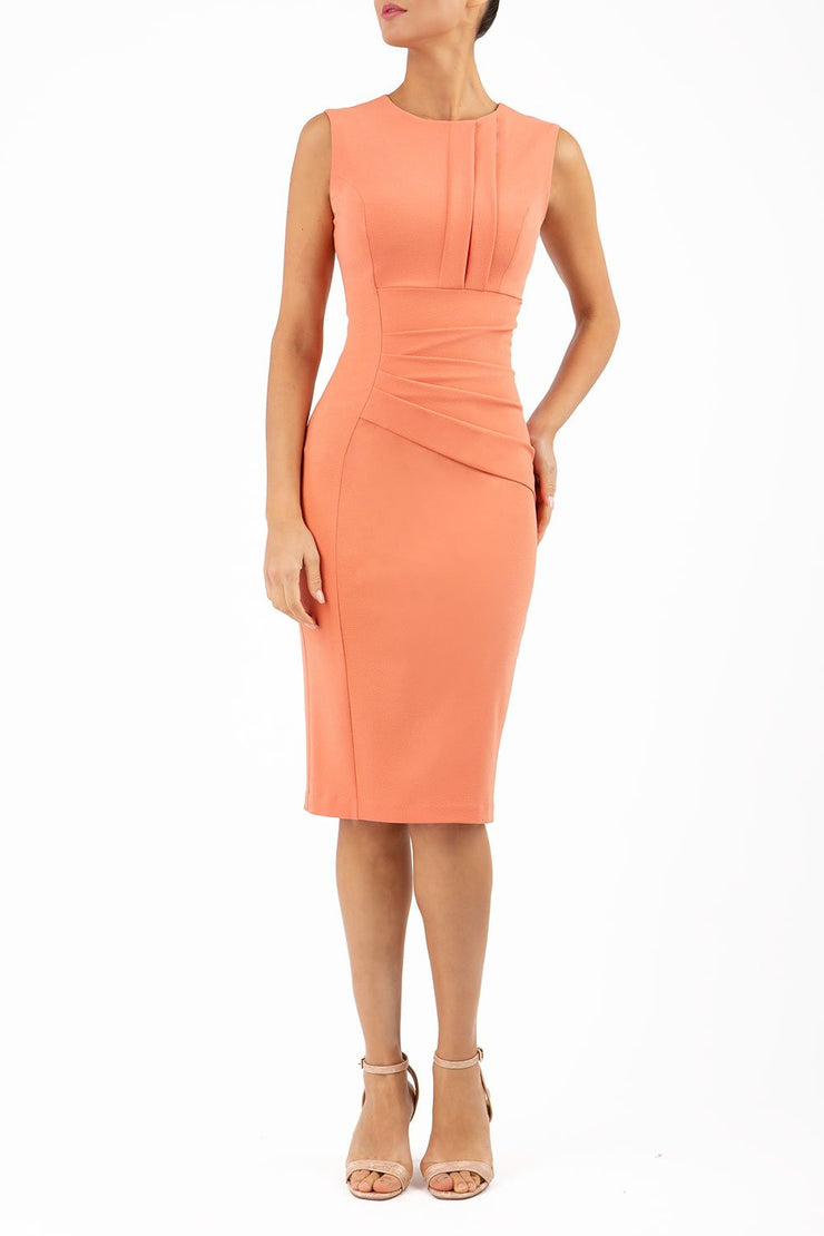 Model wearing the Diva Clara Pencil dress with vertical pleat detailing at bust sleeveless design in dusty coral front image