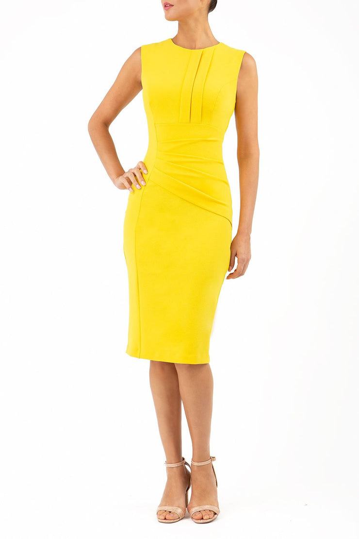 Model wearing the Diva Clara Pencil dress with vertical pleat detailing at bust sleeveless design in freesia yellow front image