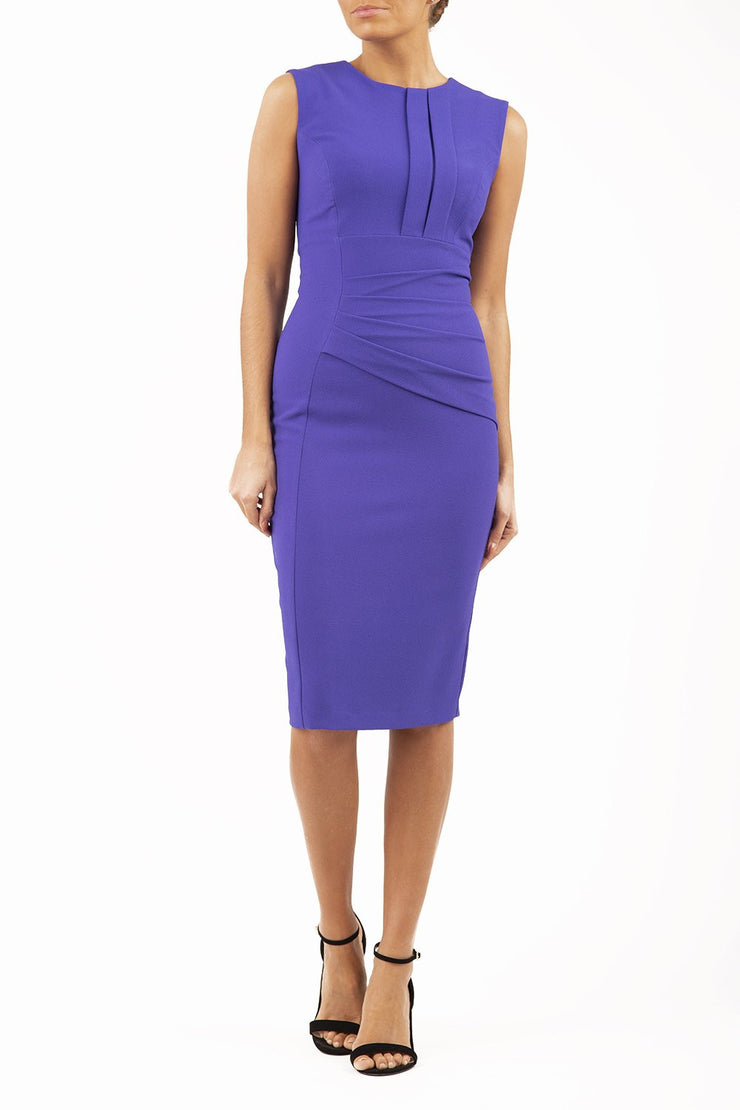Model wearing the Diva Clara Pencil dress with vertical pleat detailing at bust sleeveless design in spectrum indigo front image