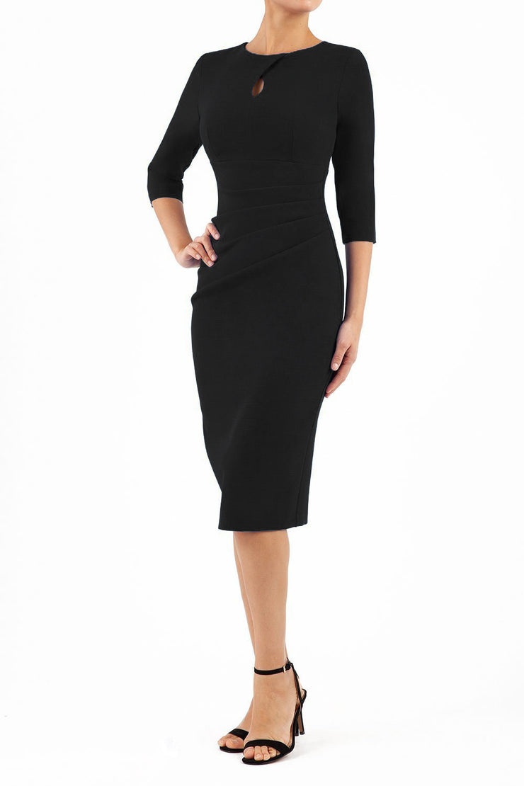 brunette model wearing diva catwalk ubrique pencil dress with a keyhole detail and sleeves in black front