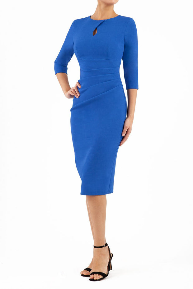 brunette model wearing diva catwalk ubrique pencil dress with a keyhole detail and sleeves in cobalt blue front