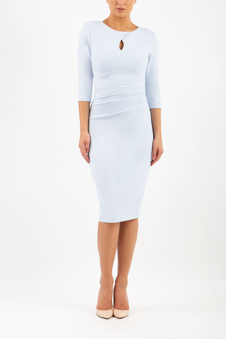 brunette model wearing diva catwalk ubrique pencil dress with a keyhole detail and sleeves in celestial blue front