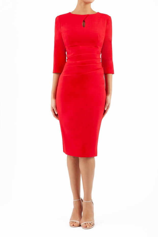 brunette model wearing diva catwalk ubrique pencil dress with a keyhole detail and sleeves in scarlet red front