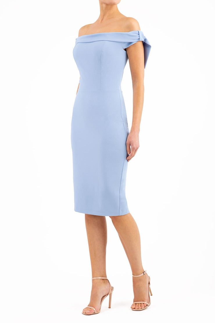 model wearing diva catwalk calista pencil plain dress off shoulder with detail falling off on a side in powder blue colour front