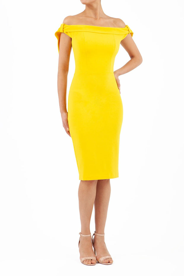 Model wearing the Diva Calista dress, off shoulder design, sleeveless pencil in freesia yellow front image