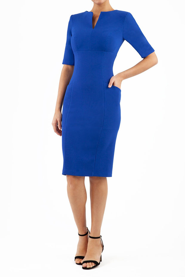 Model wearing the Diva Derwent Pencil dress with shoulder pads and short sleeves in cobalt blue front image