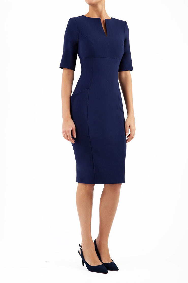 Model wearing the Diva Derwent Pencil dress with shoulder pads and short sleeves in navy blue front image