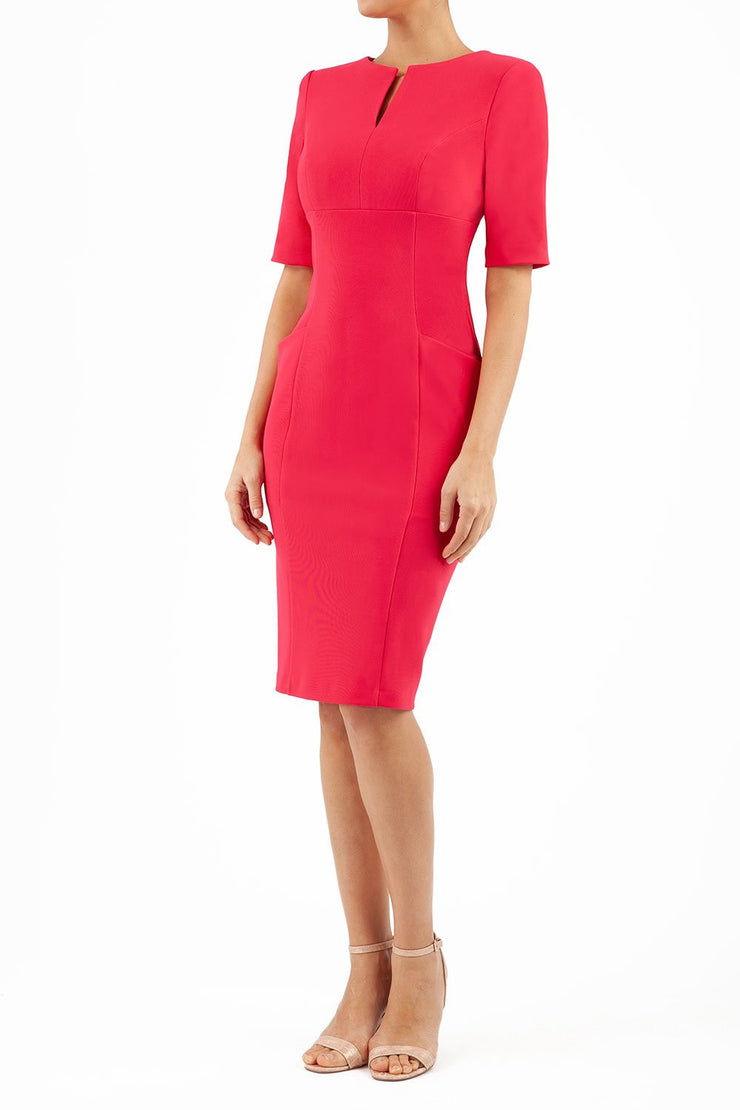 Model wearing the Diva Derwent Pencil dress with shoulder pads and short sleeves in raspberry pink front image