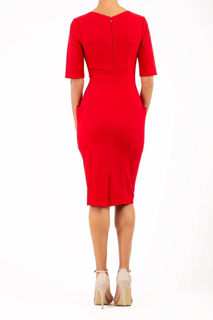 Model wearing the Diva Derwent Pencil dress with shoulder pads and short sleeves in passion red back image