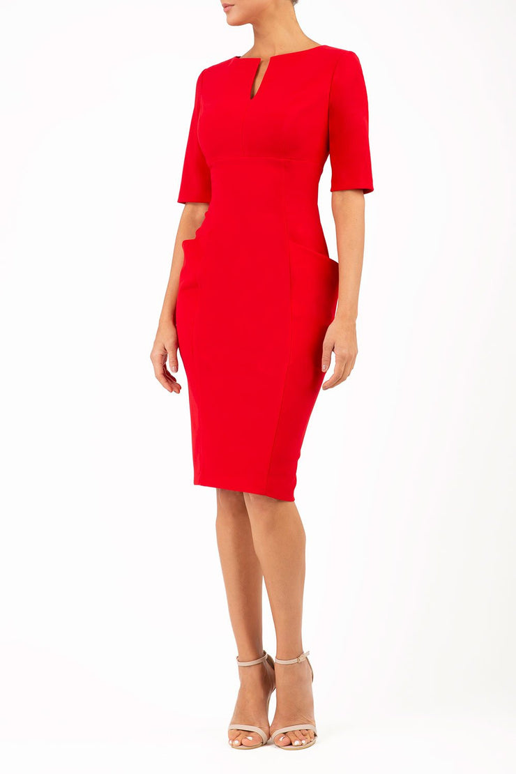 Model wearing the Diva Derwent Pencil dress with shoulder pads and short sleeves in passion red front image