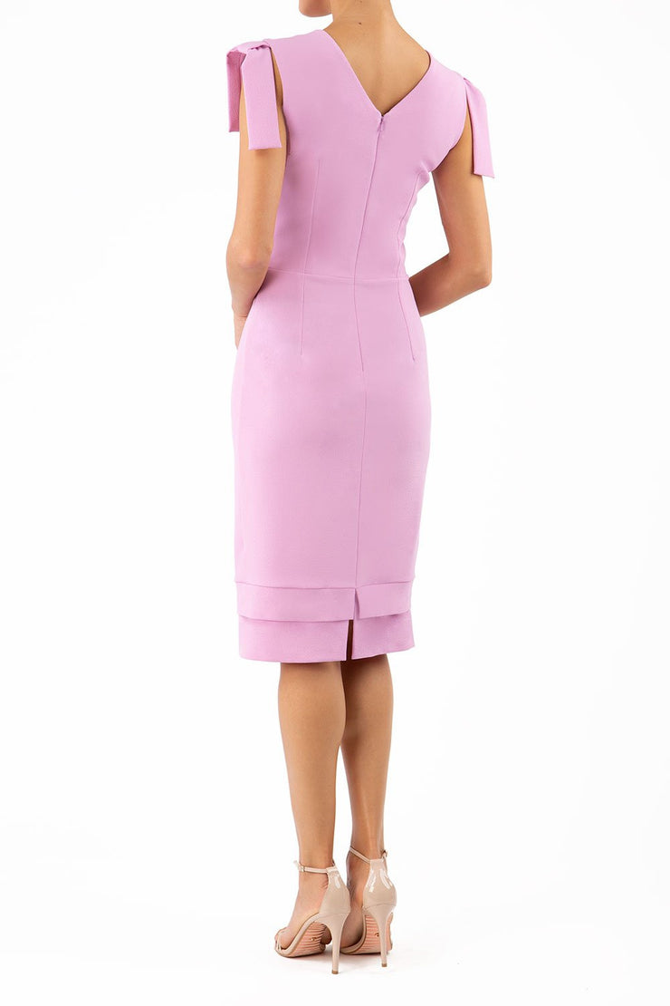 Model wearing the Diva Branwell Pencil dress with tie on shoulders in dawn pink back image