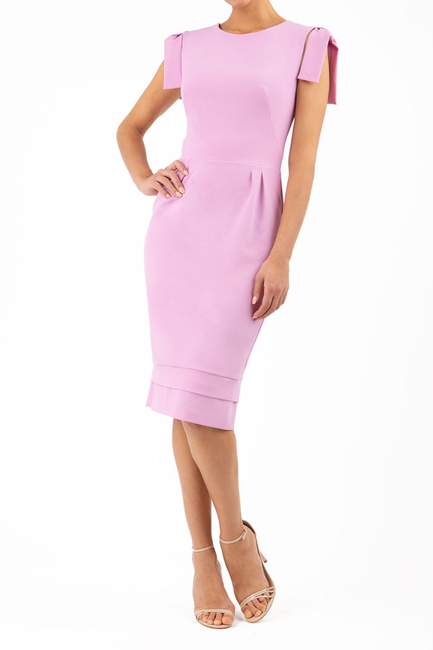 Model wearing the Diva Branwell Pencil dress with tie on shoulders in dawn pink front image