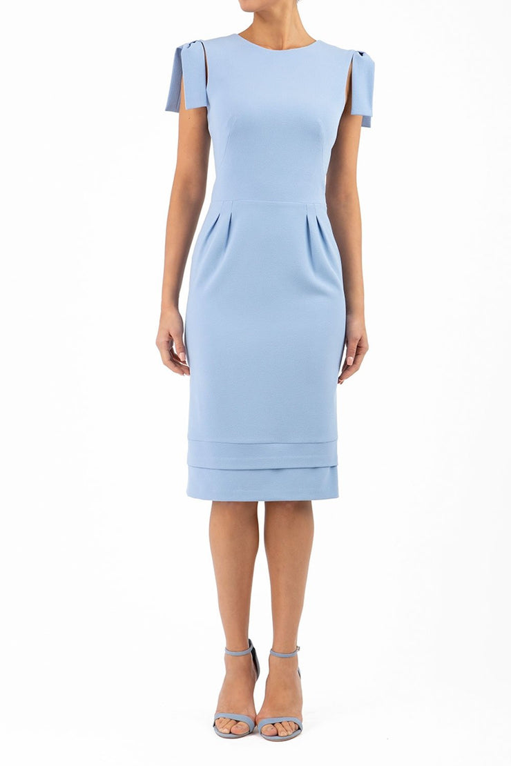 Model wearing the Diva Branwell Pencil dress with tie on shoulders in powder blue front image