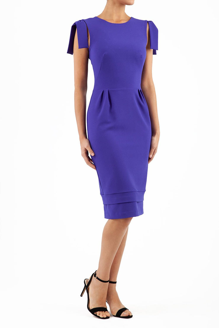 Model wearing the Diva Branwell Pencil dress with tie on shoulders in spectrum indigo front image