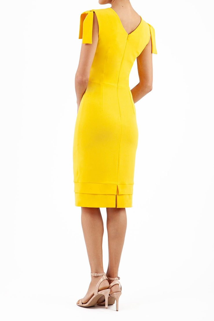 Model wearing the Diva Branwell Pencil dress with tie on shoulders in freesia yellow back image