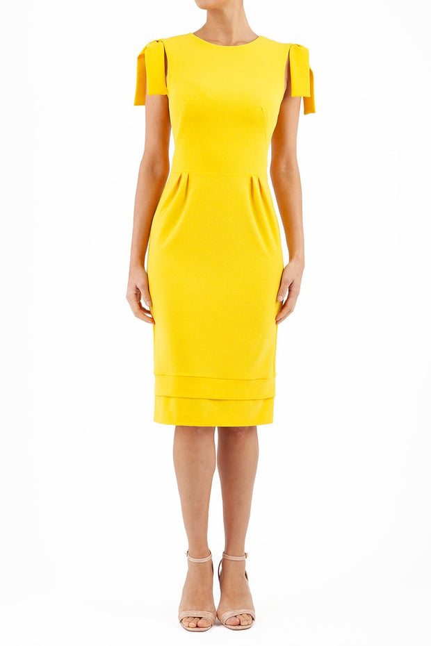 Model wearing the Diva Branwell Pencil dress with tie on shoulders in freesia yellow front image