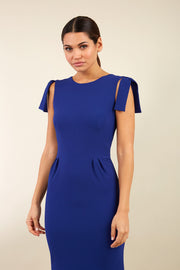 Model wearing the Diva Branwell Pencil dress with tie on shoulders in oxford blue front image