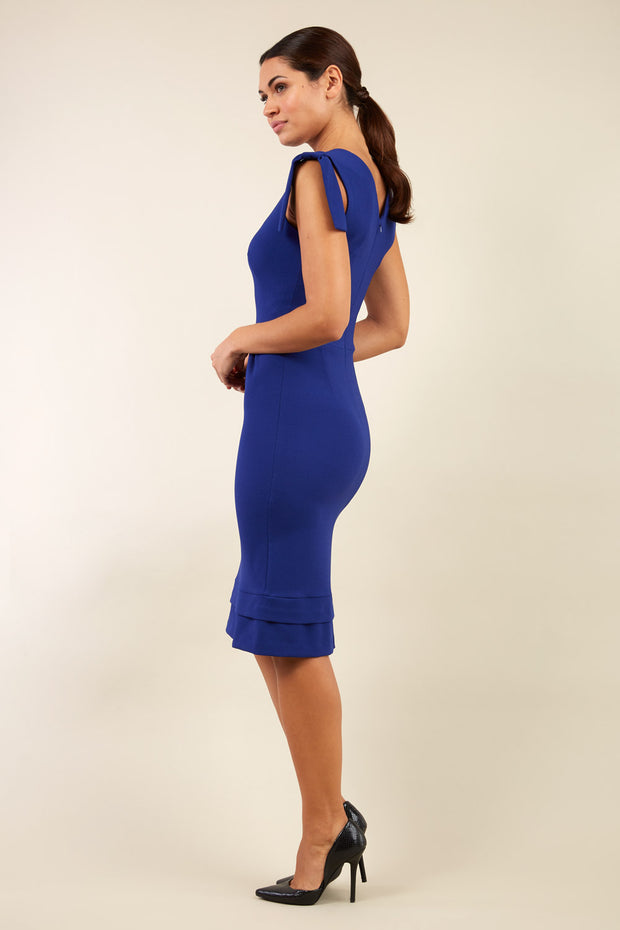 Model wearing the Diva Branwell Pencil dress with tie on shoulders in oxford blue back image