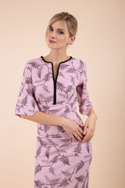 Model wearing the Diva Memphis Print dress dress in pencil dress design in dawn pink fern print front image