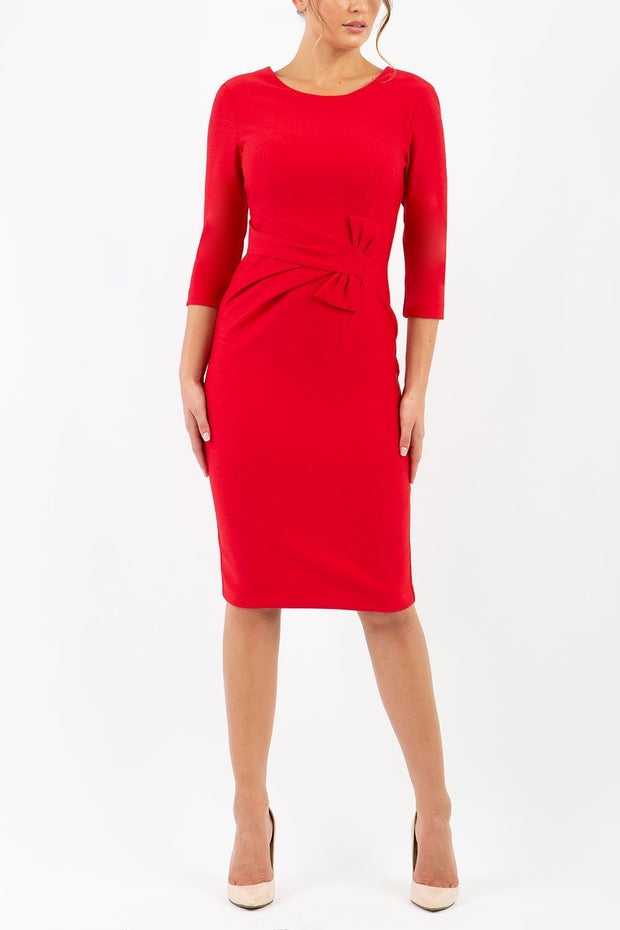 Model wearing the Seed Andante in pencil dress design in salsa red front image
