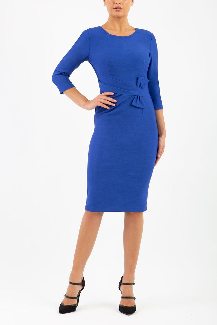 Model wearing the Seed Andante in pencil dress design in palace blue front image