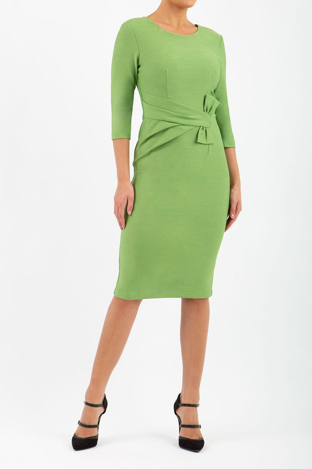 Model wearing the Seed Andante in pencil dress design in citrus green front image