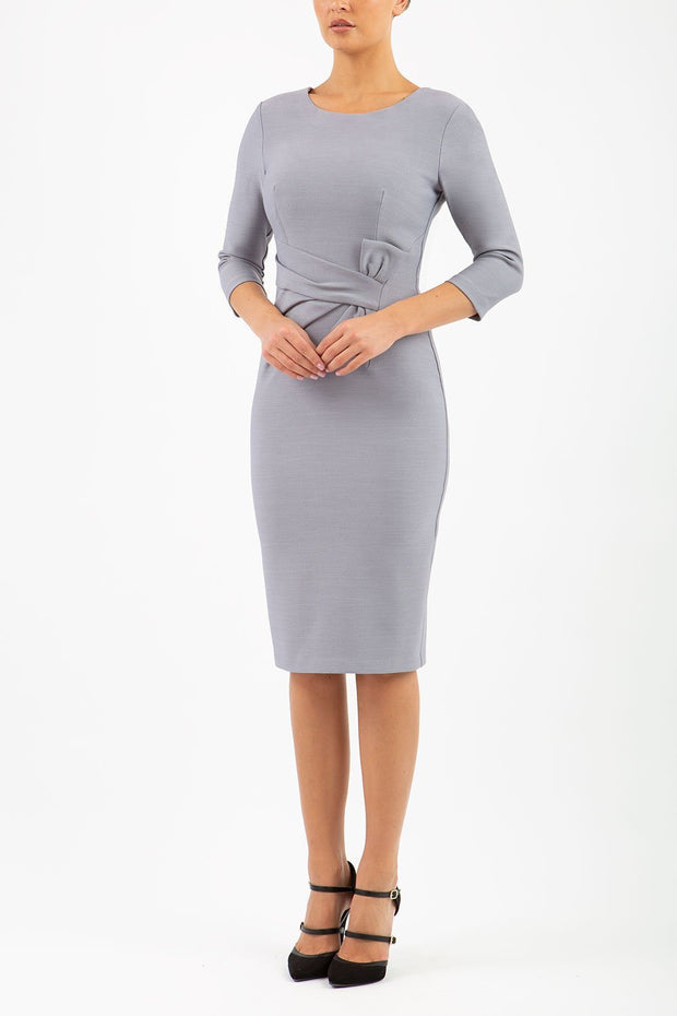 Model wearing the Seed Andante in pencil dress design in sky grey front image