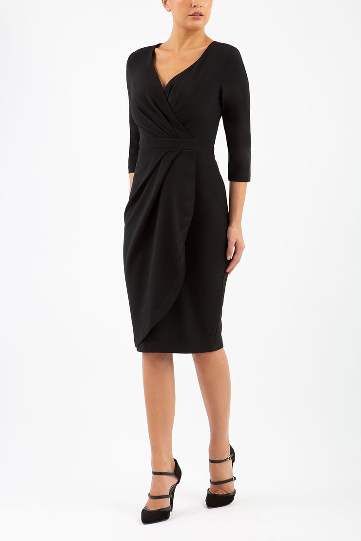 model wearing diva pencil dress tulip design with overlapping pencil skirt with 3 4 sleeves in colour black front