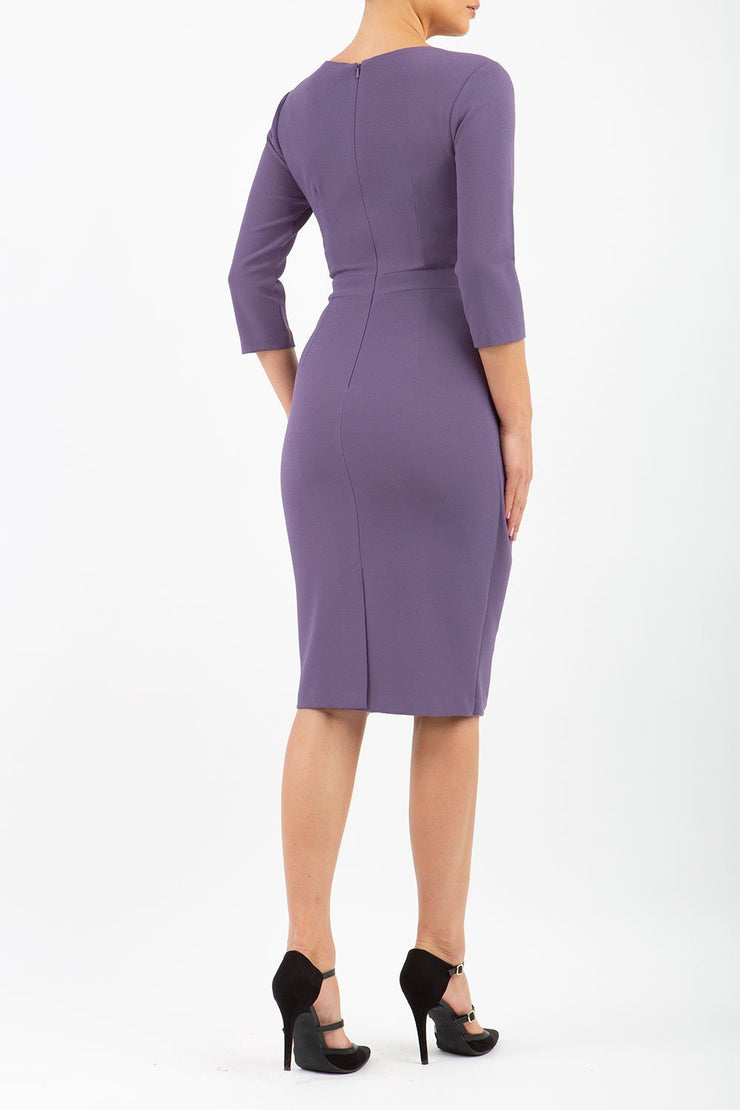 model wearing diva pencil dress tulip design with overlapping pencil skirt with 3 4 sleeves in colour dark mauve back