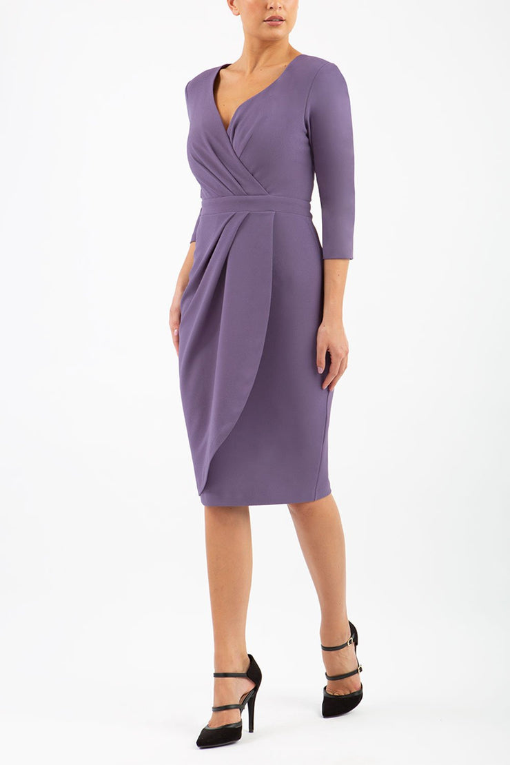 model wearing diva pencil dress tulip design with overlapping pencil skirt with 3 4 sleeves in colour dark mauve front