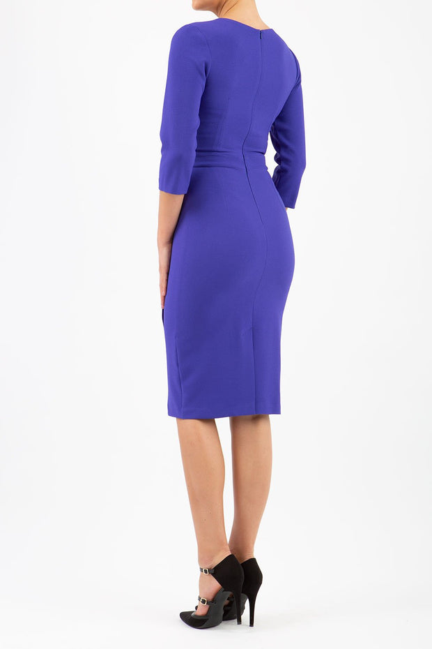 model wearing diva pencil dress tulip design with overlapping pencil skirt with 3 4 sleeves in colour spectrum indigo back